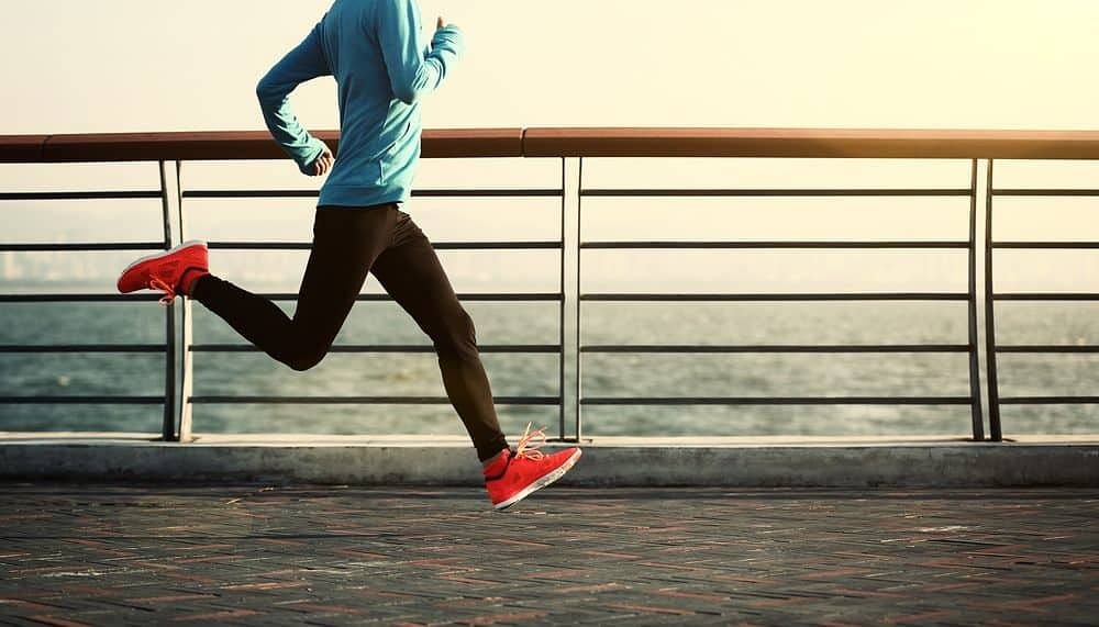 young woman running at seaside - How to Start Running As a Beginner